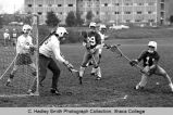 Men's lacrosse game, Ithaca varsity goalie (white shirt) blocking shot, Ithaca College, Ithaca,...