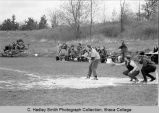 Softball game, Ithaca College women vs. Albany, action picture of Albany player at bat, on Ithaca...