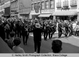 Spring Weekend parade band, Ithaca College, Ithaca, NY, 1st block of West State Street, facing...