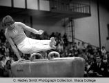 Male gymnast vaulting, in Ben Light Gym, Ithaca College, Ithaca, NY,  taken February 11, 1972.