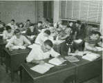 Accounting class, professor working with students, group picture in downtown classroom, Ithaca...