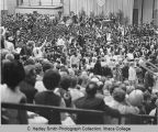 Commencement (graduation) ceremony, Nelson Rockefeller speaking, protestors leaving at front...