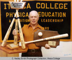 "Carlton ""Carp"" Wood posing with District Coach & Adirondack Big Stick award, Ithaca..."
