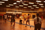 Volleyball game, Ithaca College, Ithaca, NY, men & women students, action picture in Hill...