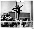 Woman gymnast on balance beam, Ithaca College, Ithaca, NY, action picture taken February 8, 1964.