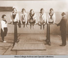 Women on parallel bars, Ithaca Conservatory and Affiliated Schools, Ithaca, NY.