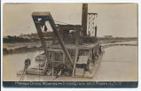 Hydraulic Dredge Working on Barge Canal Near Phoenix, N.Y. [handwritten front caption] (1front)...