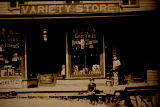 3 Children in front of Jillson's variety store