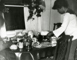 Annette Smith White setting the table at 240 McClennan Avenue.