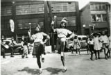 Elaine Cooper and Emily Moore, marching for the Dunbar Center, probably on Memorial Day. South...