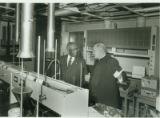Leon Modeste and Reverend Frank R. Haig, President of LeMoyne College, 1986-11