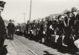 First Draft Men Preparing to Board a Train