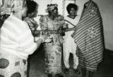 Asamoah-Wade covered with Ewe Kinte cloth gown and drape. Yvonne Wood Asamoah is to her right,...