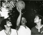 Franklin Harlow refereeing his sons, Howard and Philip, in a basketball game on Baker Street....