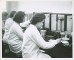 Four Russell Sage College students working in the Quantitative Laboratory