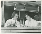 Two Russell Sage College students working in the Science Laboratory